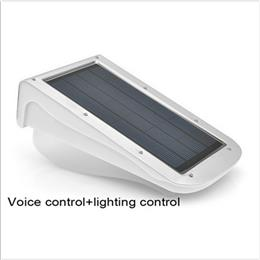 New Hot Voice Control+Lighting Control Sensor 38 LED Lamp Pure Spot Light Control Solar Powered 3W
